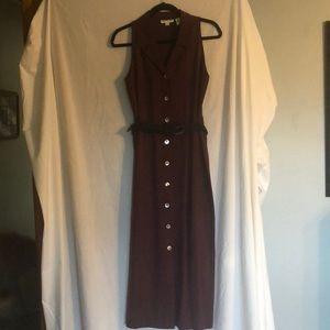 Deep purple sleeveless, button down dress.